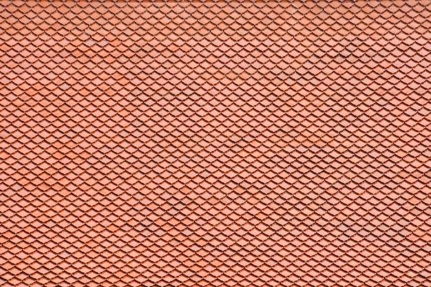 Het antieke oranje dakpatroon van de tegel bij de tempel van boedha in thailand Premium Foto