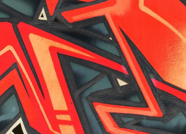 Het behangtextuur of achtergrond van het graffitidetail Premium Foto