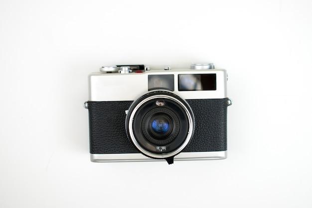 Het bovenaanzicht van een filmcamera op een wit. geïsoleerd Premium Foto