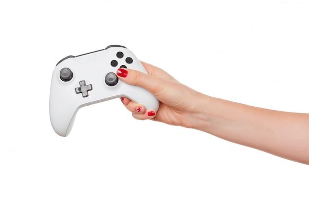 Het controlemechanisme van de videogameconsole in gamerhanden die op wit worden geïsoleerd Premium Foto