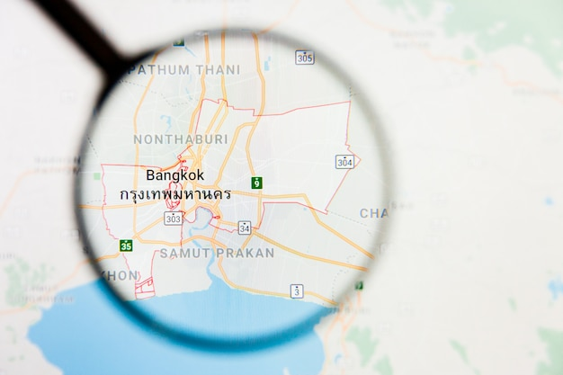 Het illustratieve concept van de de stadsvisualisatie van bangkok, thailand op het vertoningsscherm door vergrootglas Premium Foto