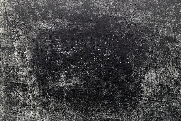 Het krijstextuur van de grunge witte kleur op zwarte raadsachtergrond Premium Foto