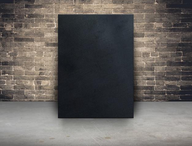 Het lege zwarte frame van het stoffencanvas bij grungebakstenen muur en concrete vloerachtergrond Premium Foto