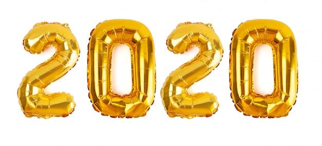 Het nummer 2020 in gouden folie ballonnen geïsoleerd op een witte achtergrond voor het nieuwe jaar Premium Foto