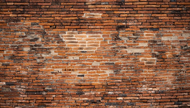 Het oude detail van de bakstenen muuroppervlakte van tempel thai in thailand Premium Foto