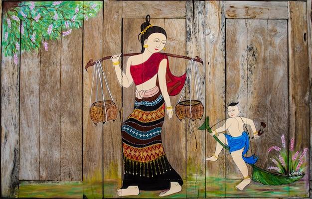 Het thaise vrouwen en kind schilderen bij venster Premium Foto