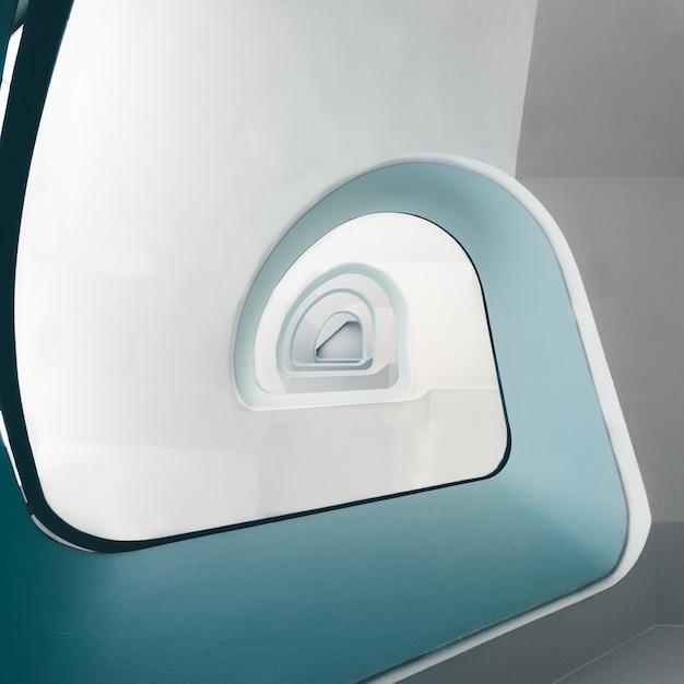 Hoge hoekmening van een moderne wenteltrap onder de lichten Gratis Foto
