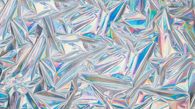 Holografische iriserende oppervlak gerimpelde dampgolfachtergrond. trendy ontwerptextuur Premium Foto