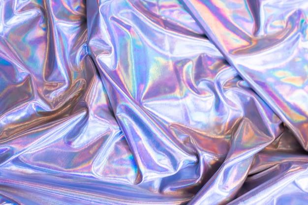 Holografische iriserende zeemeermin folie textuur achtergrond. futuristische neon trendy zilveren kleuren Premium Foto