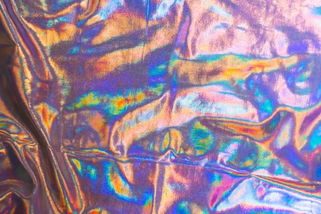 Holografische iriserende zeemeermin folie textuur. futuristische neon trendy zilveren kleuren Premium Foto