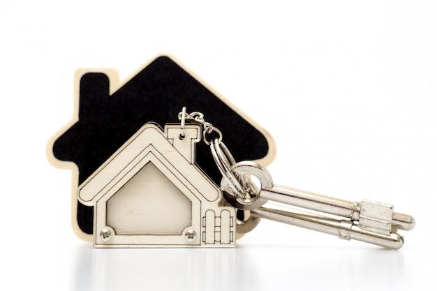 Home-toets op tabel. concept voor onroerend goedzaken. Premium Foto