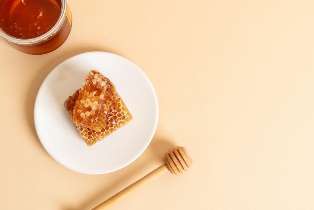 Honing en verse honingraten achtergrond Premium Foto