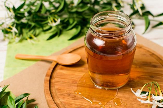 Honingpot met lepel Gratis Foto