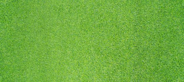 Hoogste meningsfoto, de kunstmatige groene achtergrond van de grastextuur Premium Foto