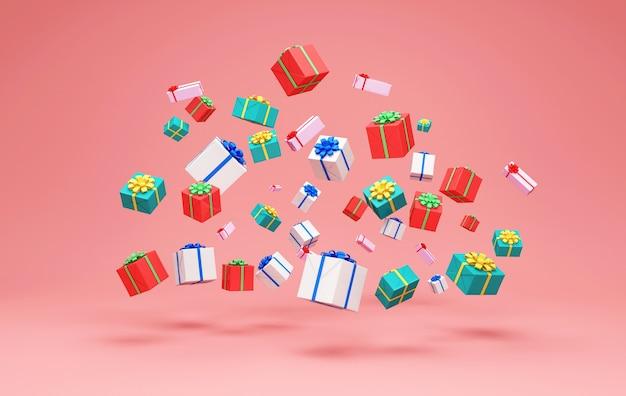 Hoop kleur geschenkdozen op roze studio achtergrond Premium Foto