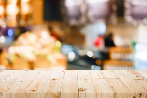 Houten lijst met onduidelijk beeldachtergrond van koffiewinkel. Premium Foto