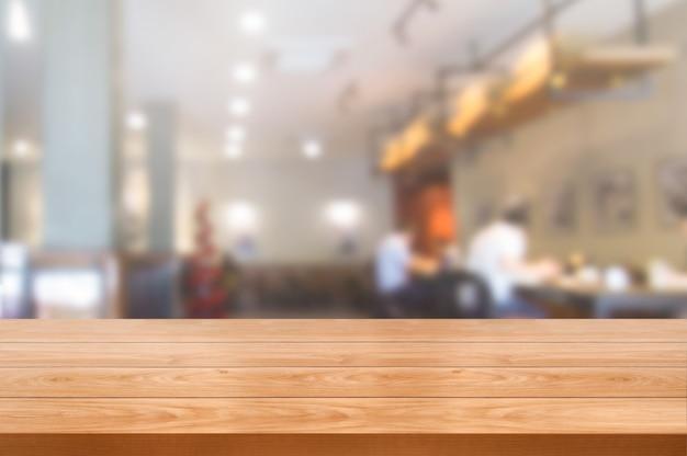 Houten lijst op onduidelijk beeldachtergrond van modern restaurant Premium Foto