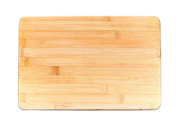Houten plaat, lade, tafel voor het koken of warme gerechten op wit wordt geïsoleerd Premium Foto