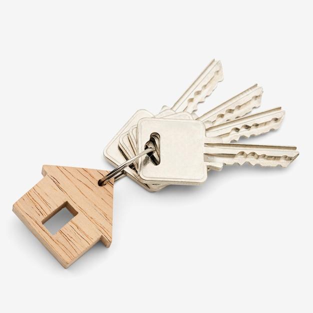 Houten sleutelhanger op wit Gratis Foto