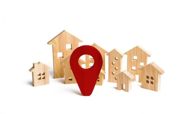 Houten stad en huizenlocatieteken. concept van stijgende prijzen voor huisvesting of huur. Premium Foto