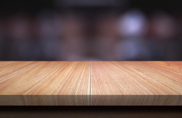 Houten tafelblad op donkere onscherpe achtergrond. Premium Foto