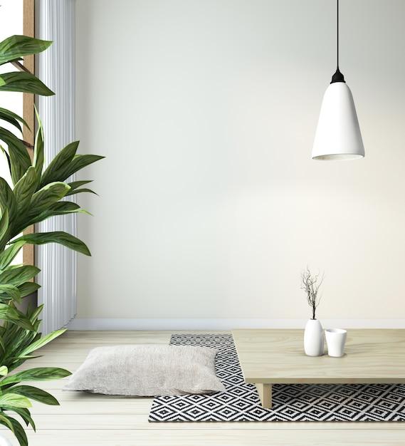 Idee van japanse woonkamer met lamp, frame, zwarte lage tafel in kamer witte muur op houten vloer. 3d-weergave Premium Foto