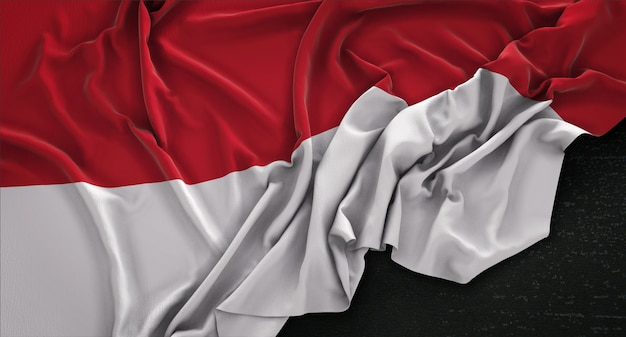 Indonesische vlag gerimpelde op donkere achtergrond 3d render Gratis Foto