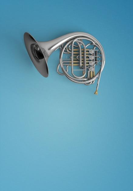 Ingetoetst trompet op een blauwe achtergrond Gratis Foto