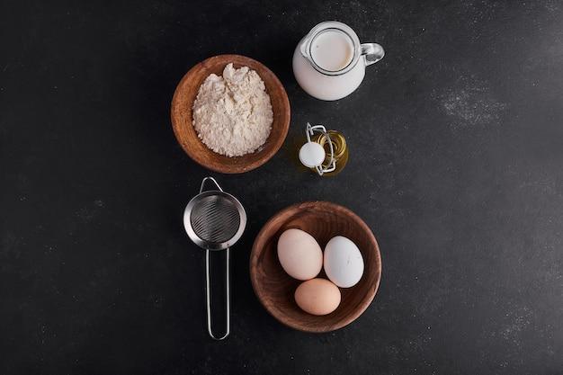 Ingrediënten voor het maken van bakkerij of banket, bovenaanzicht. Gratis Foto