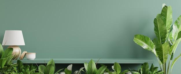 Interieur muur mockup met groene plant, groene muur en plank. 3d-rendering Gratis Foto