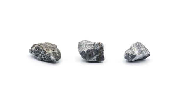 Inzameling van een kleine rots die op witte achtergrond wordt geïsoleerd Premium Foto