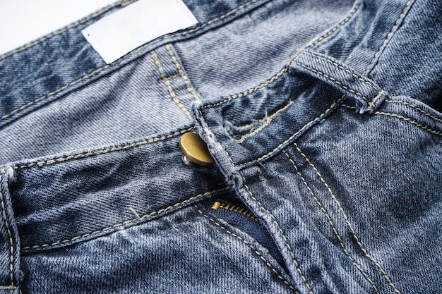 Jeans achtergrond, denim met naad van modevormgeving, plaats voor tekst. Premium Foto