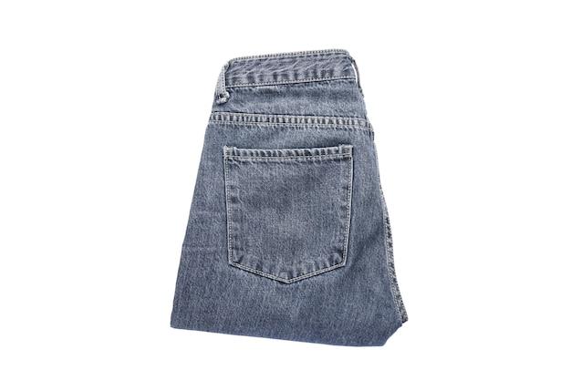 Jeans op de achtergrond. jeans op een witte geïsoleerde achtergrond, bovenaanzicht. Premium Foto