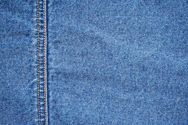 Jeans textuur. blauwe achtergrond, denim jeans achtergrond. Premium Foto