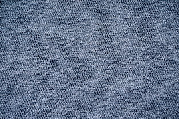 Jeans textuur, denim jeans achtergrond. bovenaanzicht, plaats voor tekst. Premium Foto