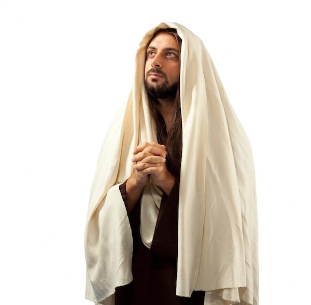 Jezus christus bidt met gevouwen handen Premium Foto