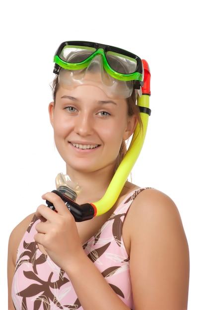 Jong meisje met een masker voor duiken geïsoleerd op wit Premium Foto