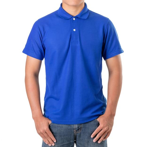 Jonge aziatische man draagt een blauwe polot-shirt Premium Foto