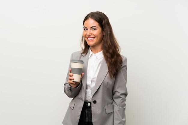 Jonge bedrijfsvrouw over geïsoleerde witte muur Premium Foto