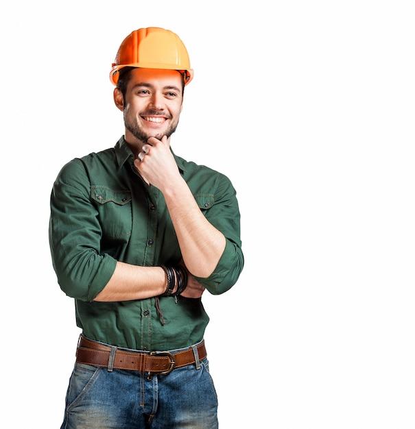 Jonge bouwvakkers in harde hoeden Premium Foto