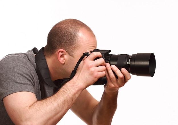 Jonge fotograaf die foto neemt Premium Foto