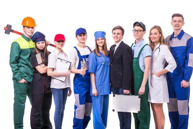 Jonge groep fabrieksarbeiders. Premium Foto