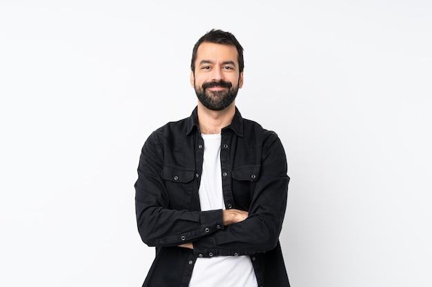 Jonge man met baard over geïsoleerde houden de armen gekruist in frontale positie Premium Foto