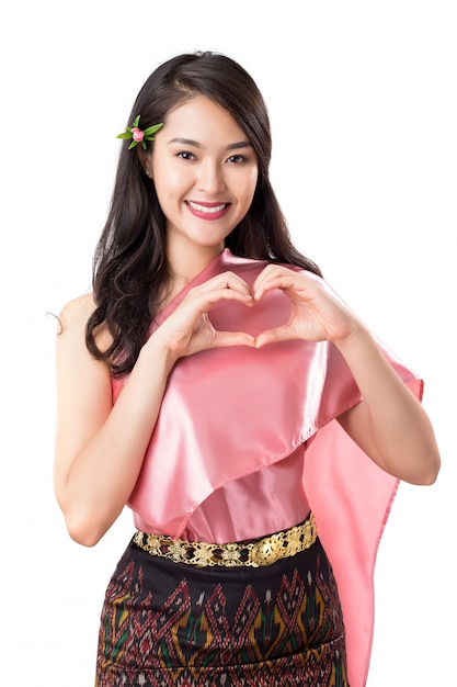 Jonge mooie thaise vrouwen die in traditiekostuums