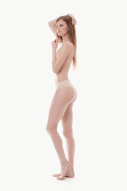 Jonge vrouw die topless, perfecte huid stelt Gratis Foto