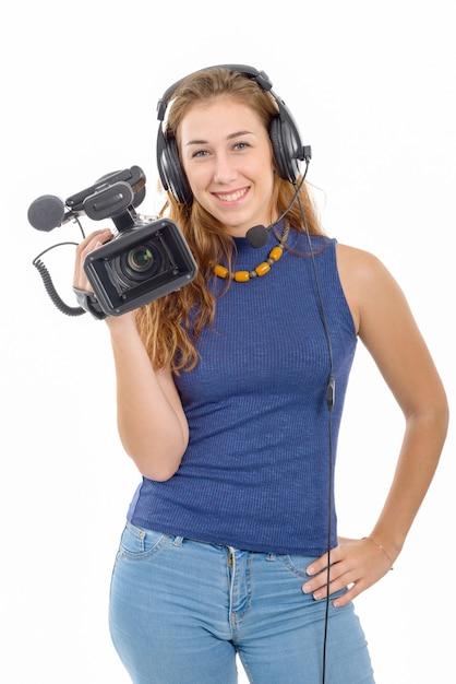 Jonge vrouw met een videocamera, op witte achtergrond Premium Foto