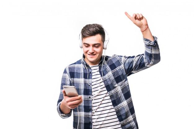 Jongen luisteren muziek met zijn nieuwe koptelefoon Gratis Foto