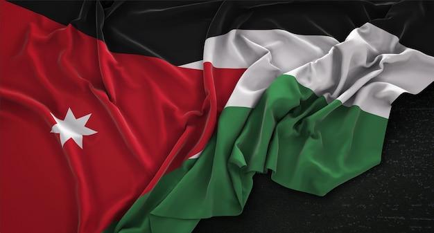Jordanië vlag gerimpeld op donkere achtergrond 3d render Gratis Foto