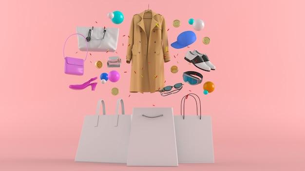Jurken, broeken, sweatshirts, hoeden, portemonnees, hoge hakken en zonnebrillen tussen kleurrijke ballen op roze Premium Foto