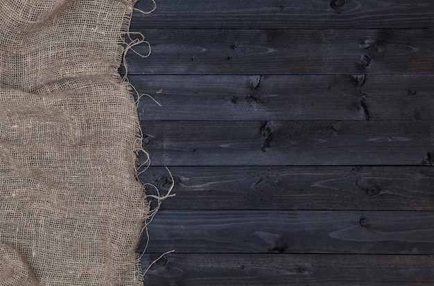 Jutejute of het ontslaan op donkere houten achtergrond Premium Foto